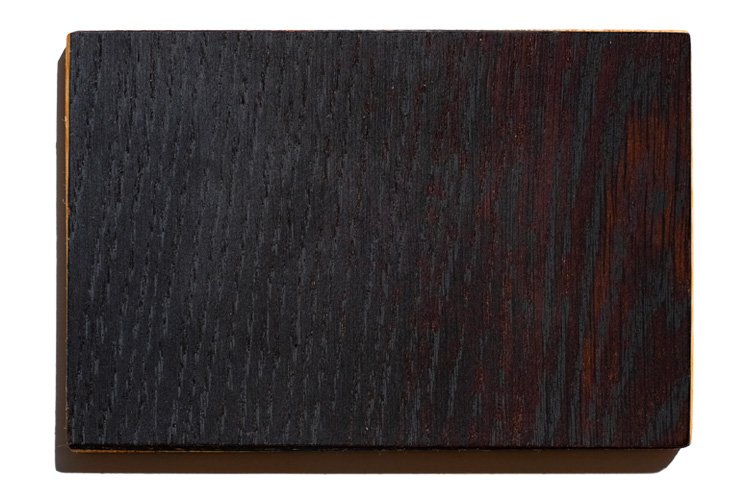 abonos is a fossil wood and is one of the finish of the sandyshapes snowboards, with a black and red/brown color